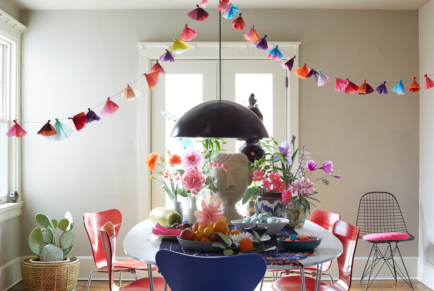 An easter table in blooming color decorating lonny handmade paper flowers and a tissue garland take center stage innbspthis bountiful tabletop idea mightylinksfo