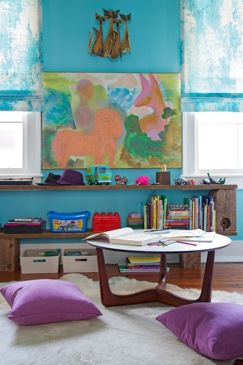 In the kids' bedroom, pine shelving and a Brazilian cowhide rug provide texture against turquoise blue walls.