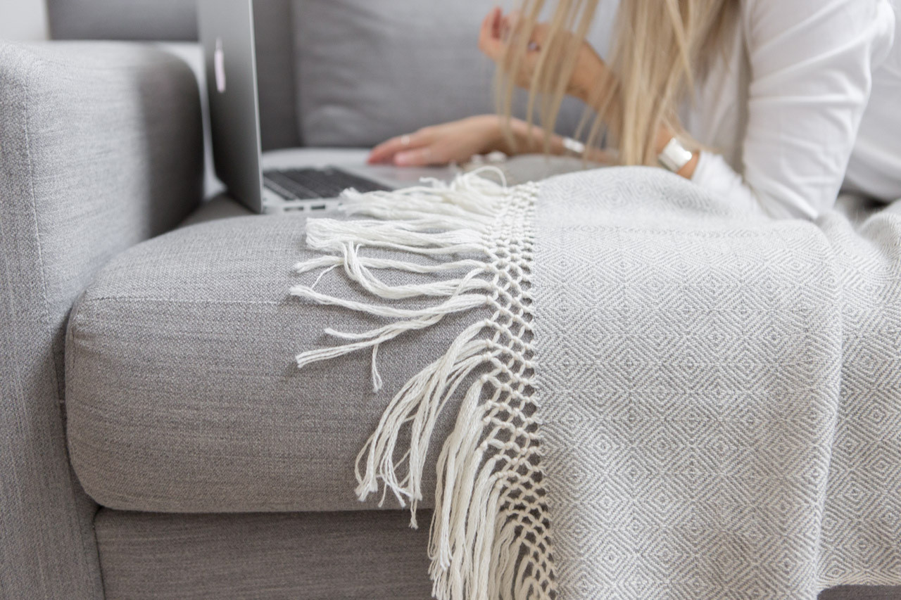 A fringed throw by The Citizenry adds texture to Babuskova's streamlined sofa.