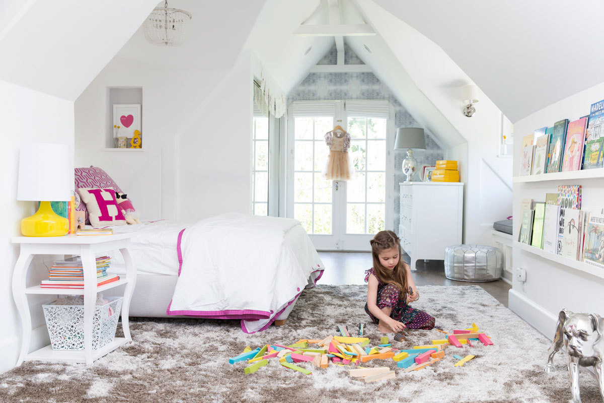 Sloping ceilings, nooks for reading, and hooks for playing dress-up make this the ideal bedroom for a little girl.