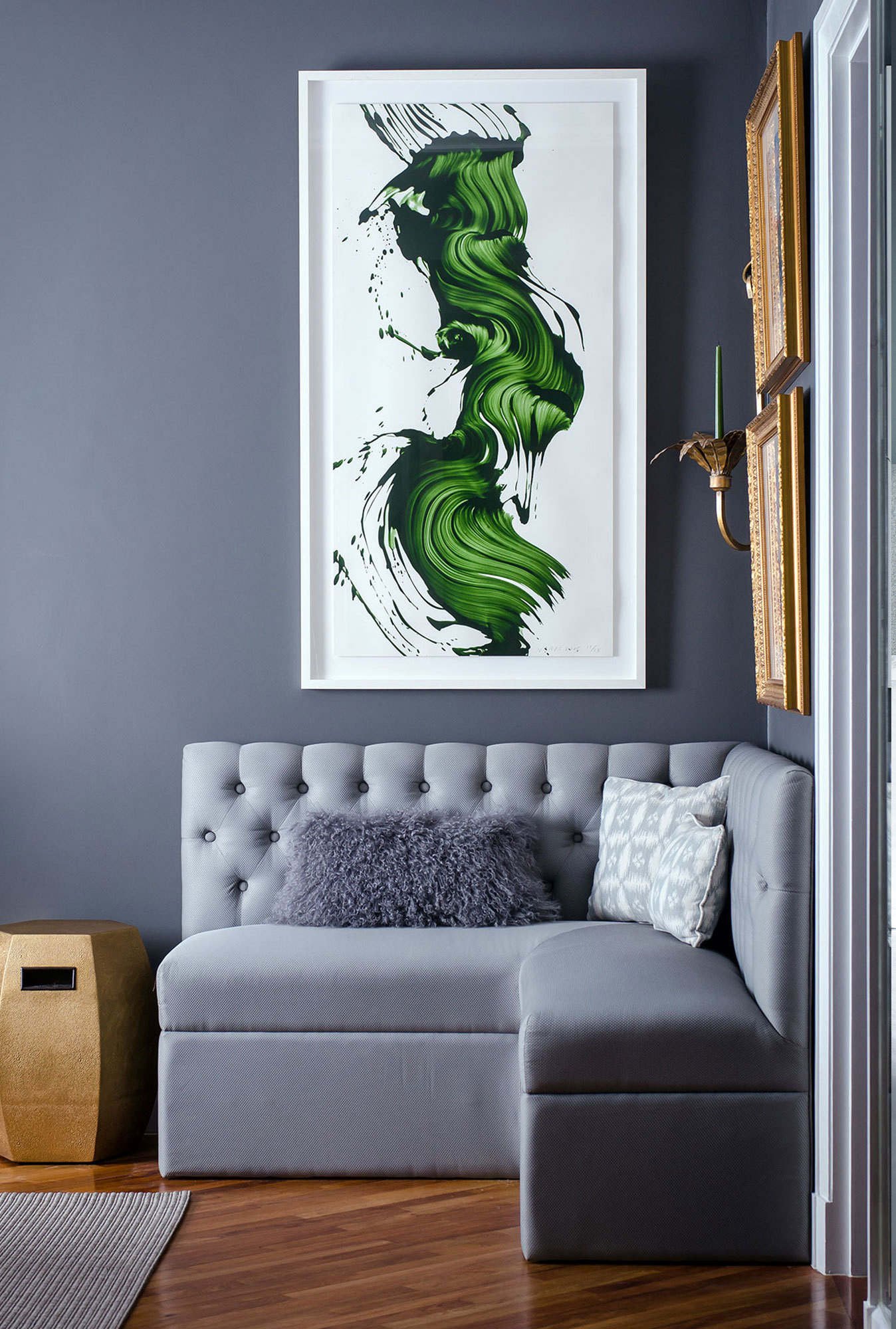 A James Nares lithograph hangs above a corner banquette.
