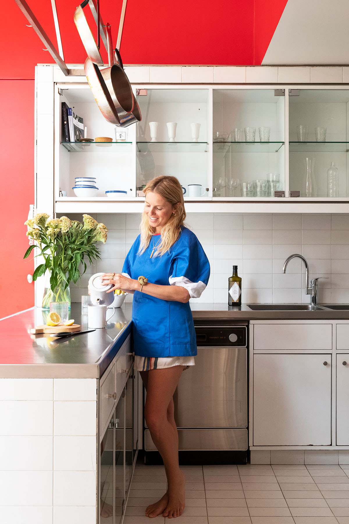 """I&squot;ve learned to love the color,"" says the designer of her bright red kitchen. Gaggenau Appliances 