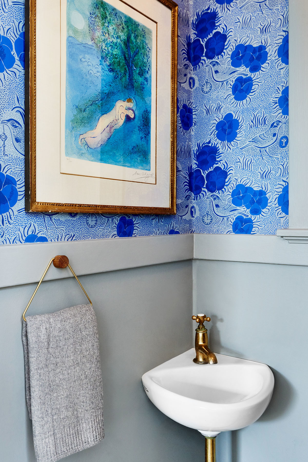 The designer gives tiny Art Deco spaces new life with bold, eclectic wallpaper. Tiina The Store Wallpaper | Marc Chagall Vintage Artwork | Waterworks Hardware.