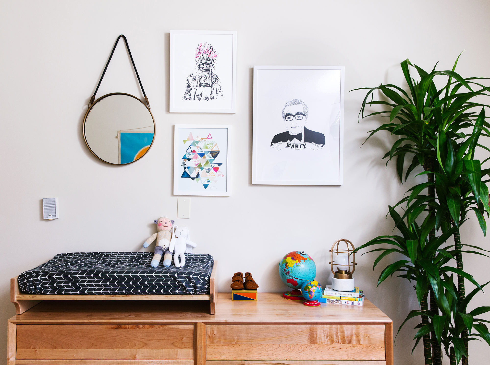 A lovingly curated gallery wall includes works from Tappan Collective and a mirror from Anthropologie.