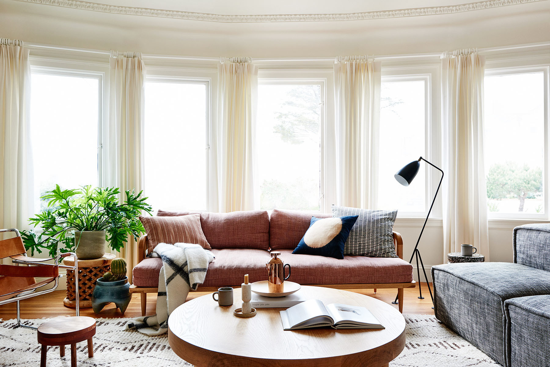 Interior designer Katie Martinez decorates her Outer Richmond home with eclectic, mid-century finds and sentimental family heirlooms. Chop Wood Co. Custom Sofa | Article Armchairs | Vintage Armchairs | Erica Tanov, Amber Interiors, Aesthetic Union Pillows | Parachute Throw | Armadillo Rug | Anthropologie Side Table | Nickey Kehoe Coffee Table | Gubi Floor Lamp | Vintage Planter | Max Lamb Stool | General Store Stool | Tom Dixon French Press | Blackcreek Mercantile & Trading Co. Bowl.