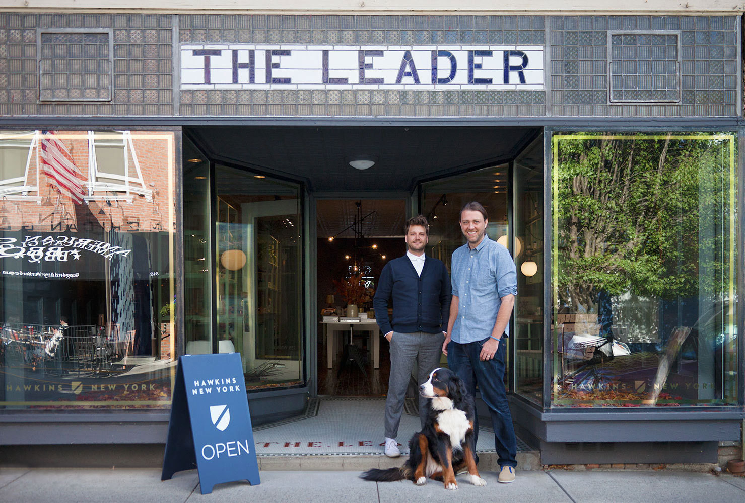Nicholas Blaine (left) and Paul Denoly of Hawkins New York—with mascot Charlie—in front of their Hudson Valley design shop.