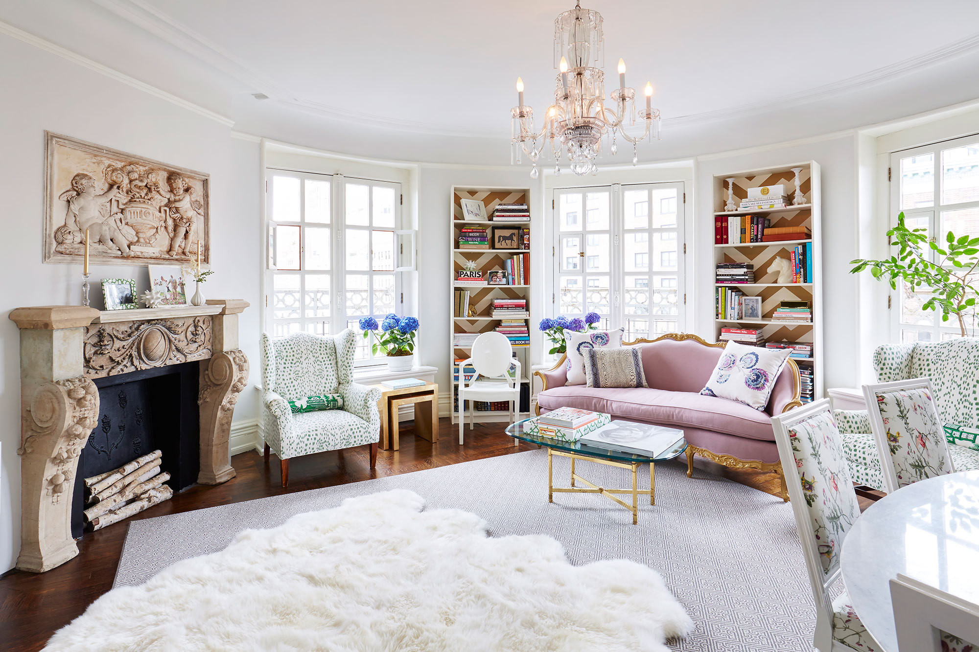 Hints of pink  green and purple cover the white sun filled living A Feminine French Inspired Home on Upper West Side Tour