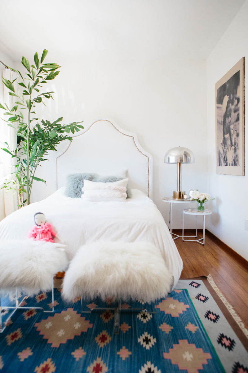 A feathery fishtail palm nestles in a bright corner of Elle's bedroom.