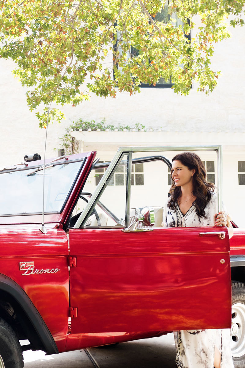 Designer Katie Kime rides around town in a 1975 Ford Bronco that's parked outside her home.