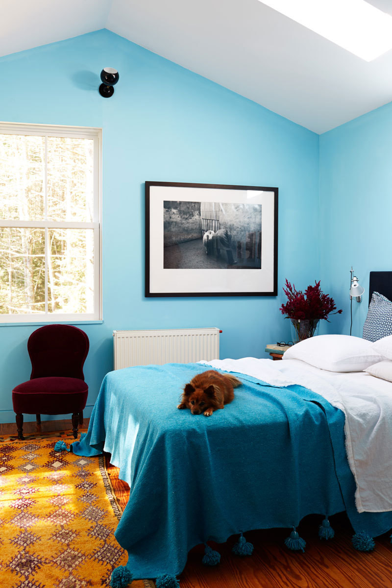 Turquoise, ocher, and crimson create a cohesive palette in the master bedroom.