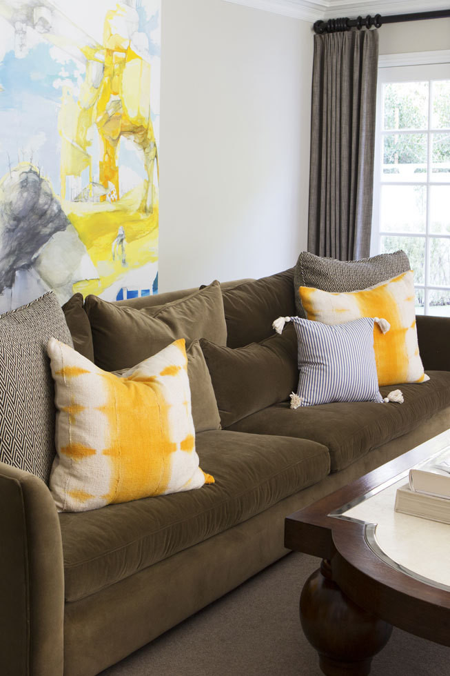the living room with its deep velvet sofa and vibrant accents is as - Kid Friendly Couches