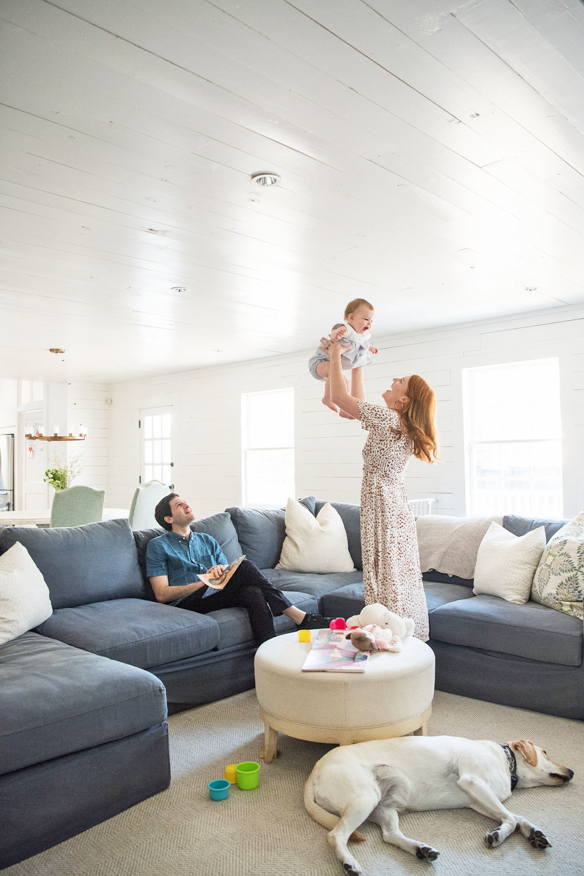 """""""I love that our family room is filled with toys and a comfy couch and large TV — it's just asking for family lounge time,"""" says Eichholz.Crate and Barrel Sofa 