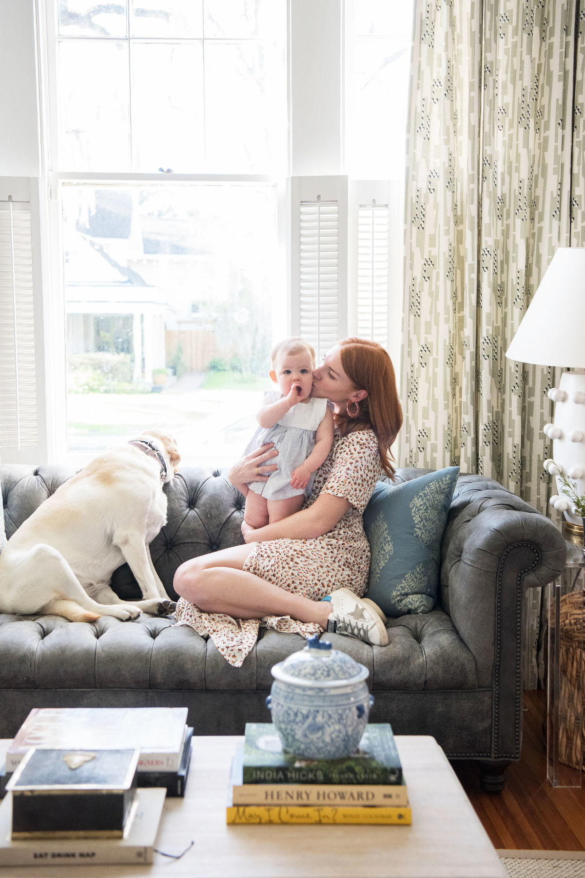 Eichholz (pictured here with daughter Tempe and labrador, Lola) admits the sitting room is her favorite space within the home.