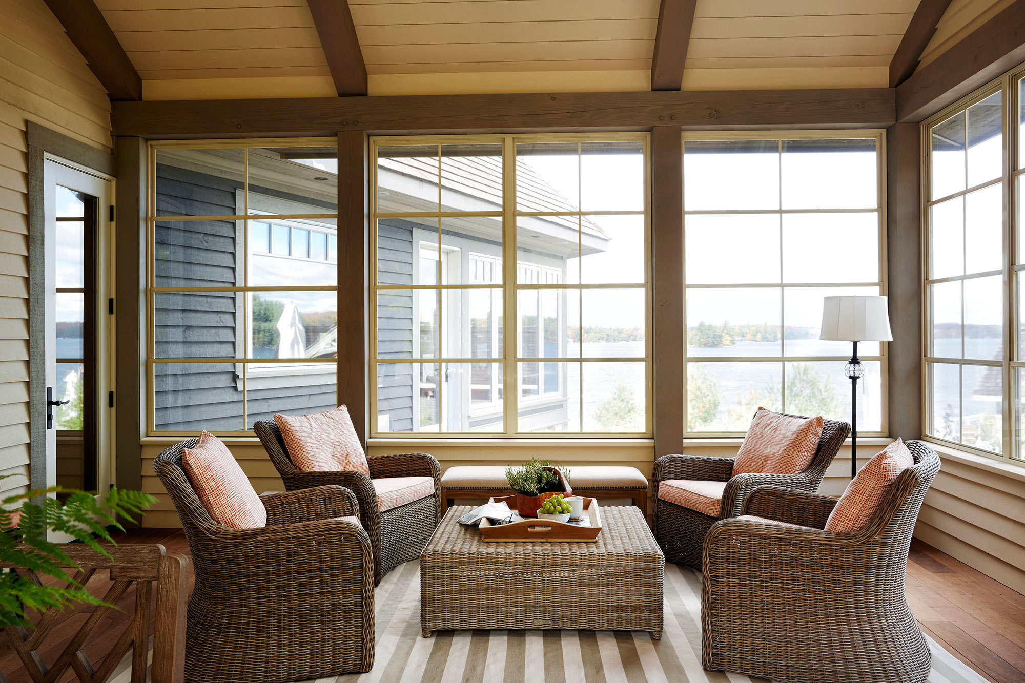 In the three-season Muskoka Room, ipe decking and furniture in handwoven wicker make for an indoor-outdoor atmosphere.