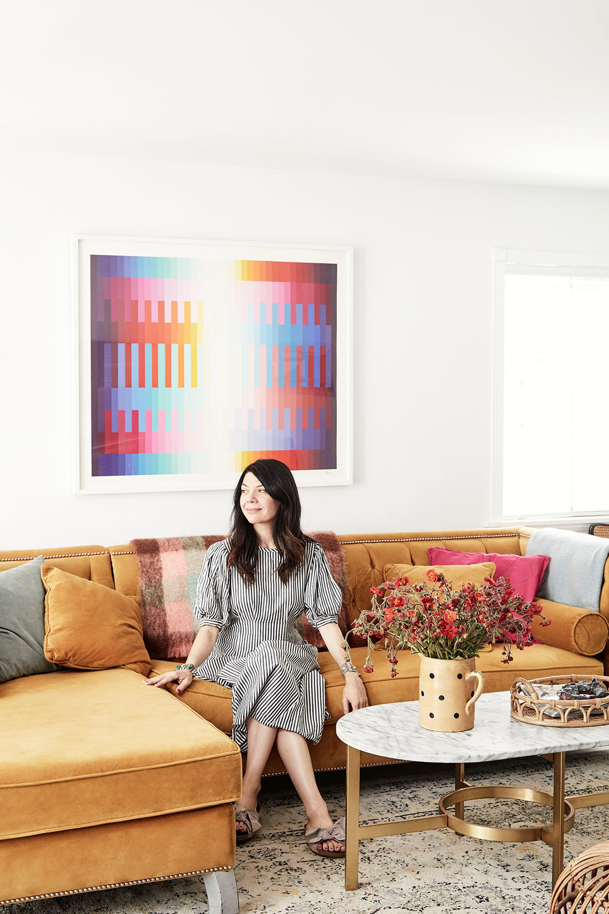 """I try to combine my 1970s Brooklyn brownstone upbringing with my current love for Southern California,"" explains the designer. ""So you&squot;ll notice a lot of books and art, combined with a lot of outdoor living."" West Elm Coffee Table 
