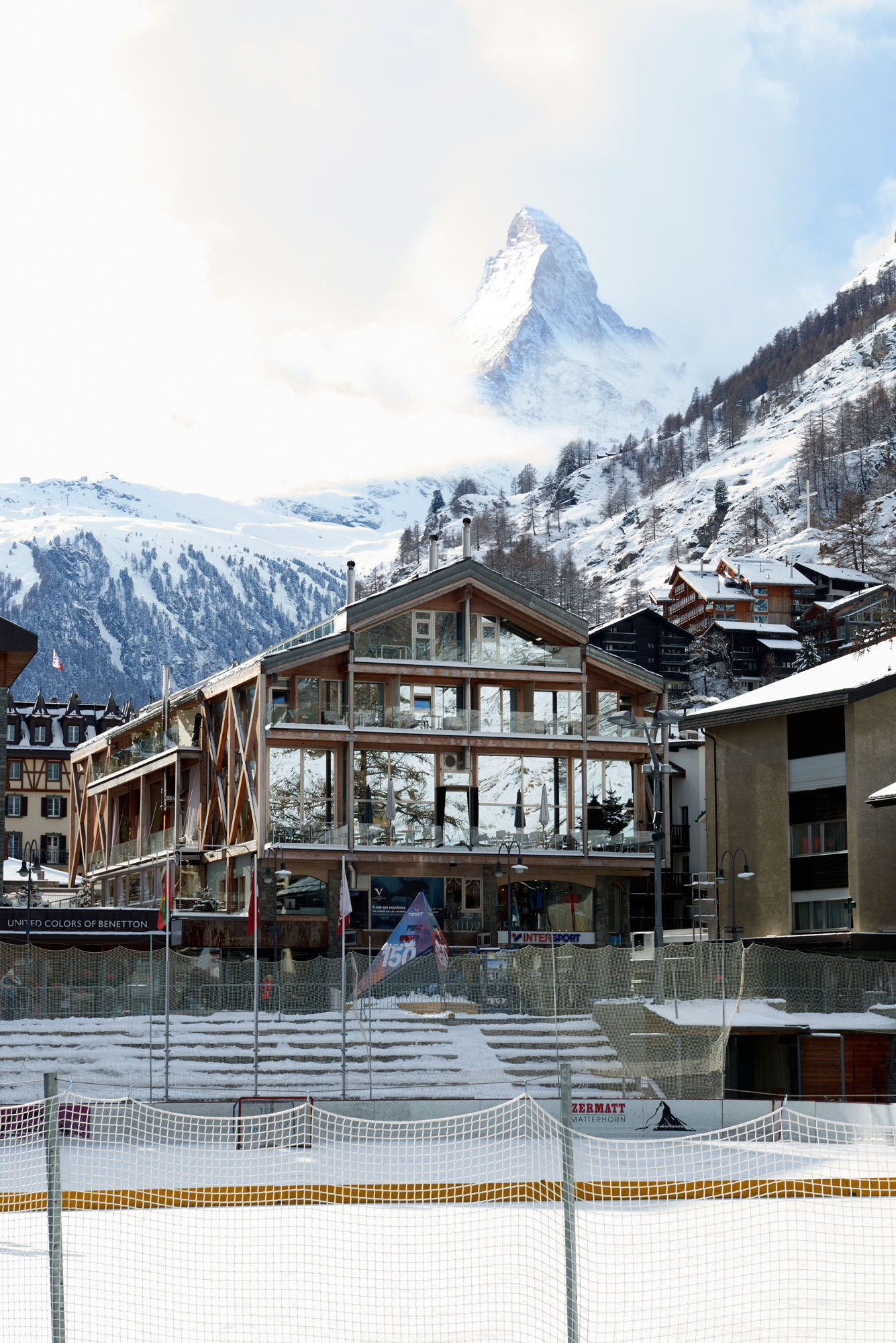 The iconic Matterhorn looms over Backstage Hotel and Spa, its soaring glass façade bisected by wood beams and balconies.