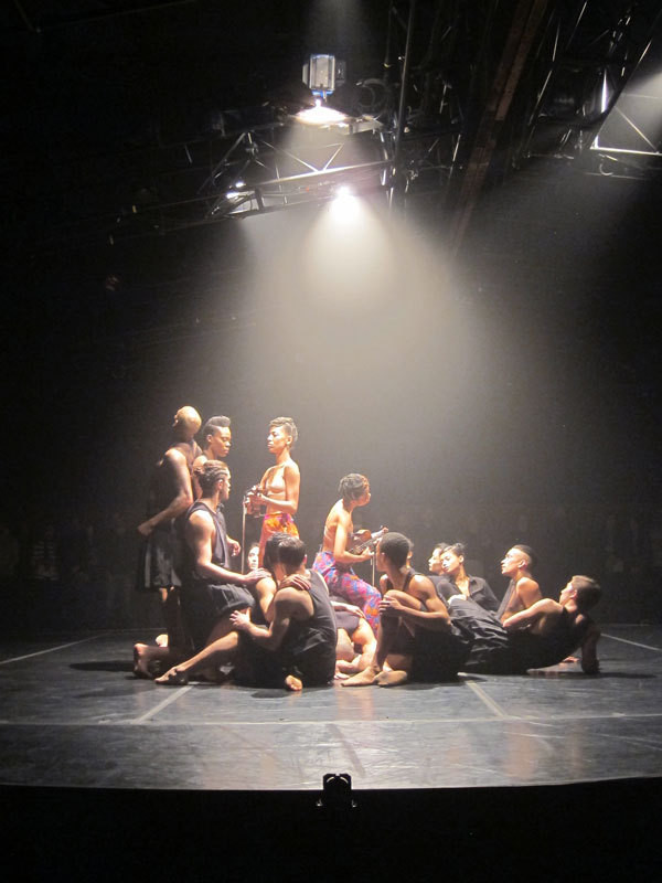 Dancers and musicians gather under Nicholas Houfek's intimate lighting.