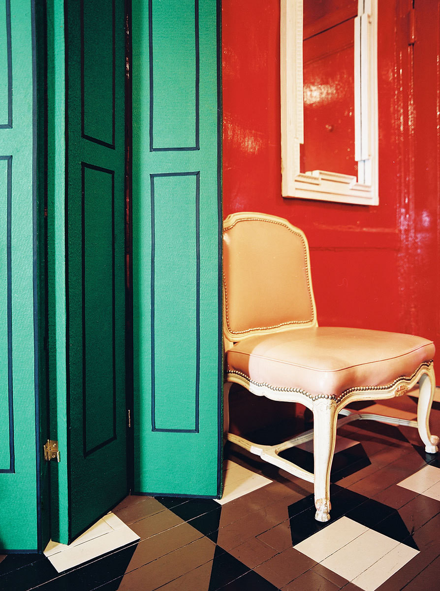 Olsen constructed the green folding screen in his living room by spray mounting green felt to the wood.