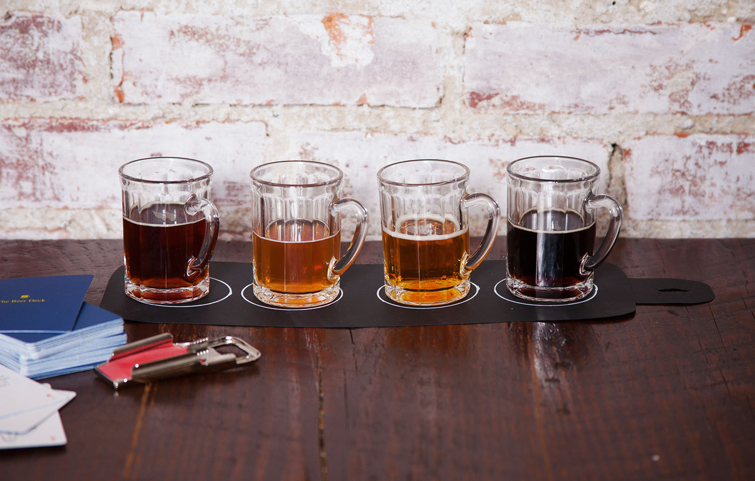 An individual flight of beers. From left:Freigeist Hoppeditz, Hitachino Nest Red Rice Ale, Gigantic IPA, andthe Tom Green Beer. Istikan Mini Beer Mugsby Fishs Eddy