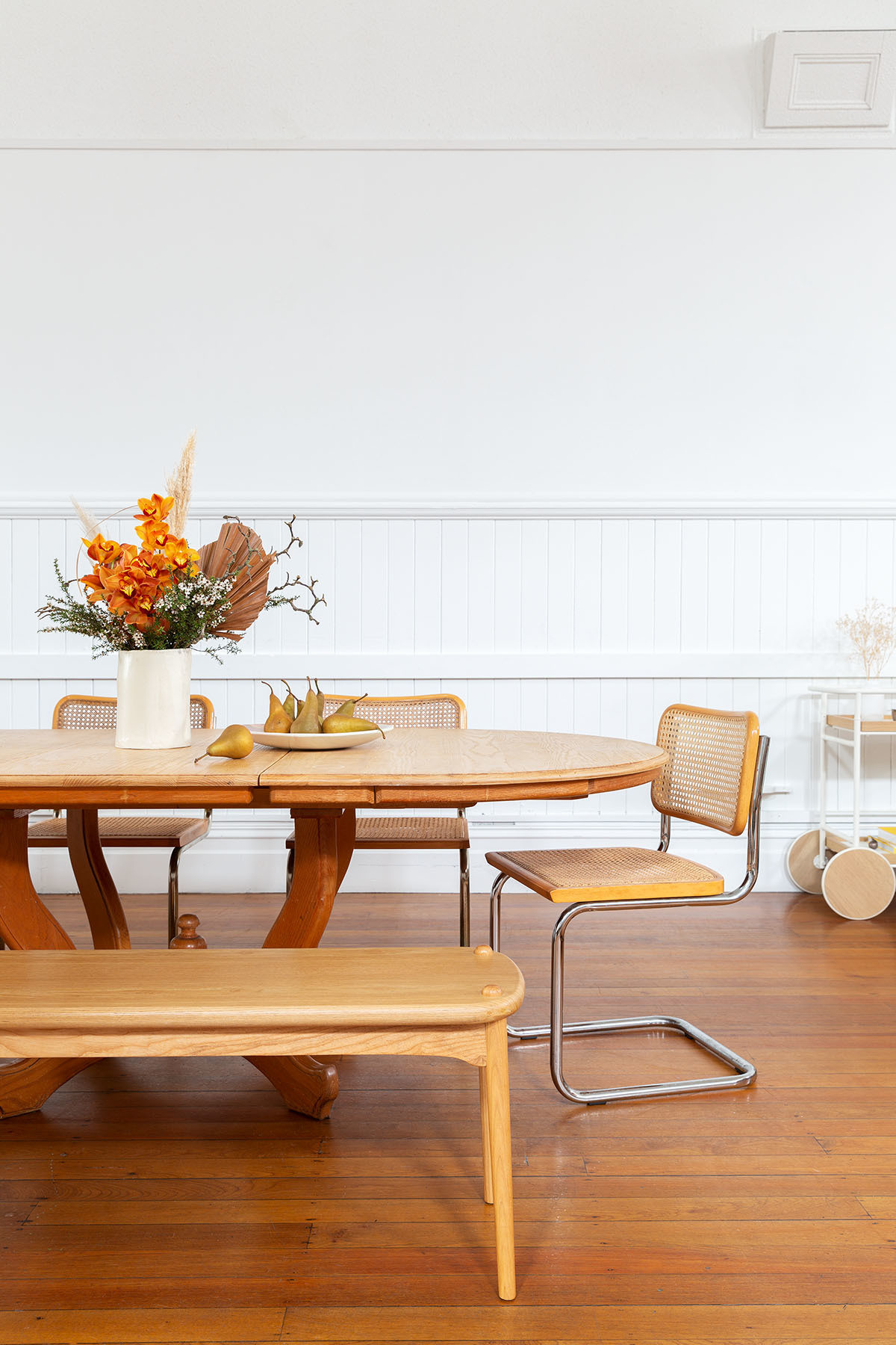 The couple carved out a contemporary dining nook within the wide open space, complete with a family heirloom dining table and vintage Marcel Breuer chairs. Heirloom Dining Table | Marcel Breuer Dining Chairs | Custom Vase | Asili Serving Dish.